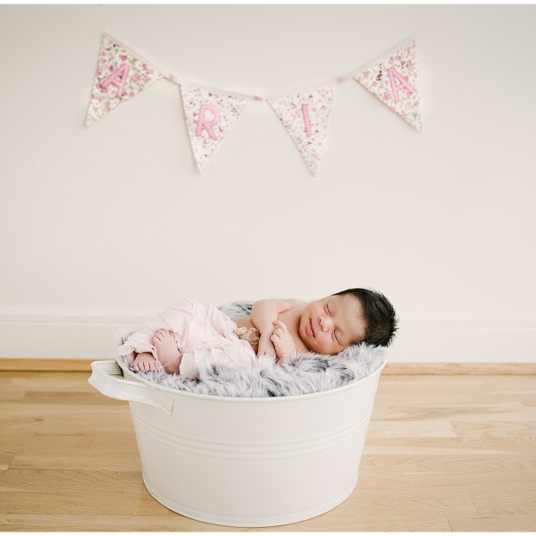 Newborn photography session with baby Aria.
